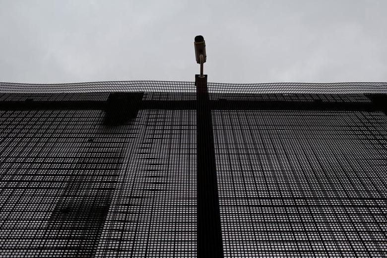 A surveillance camera is pictured atop the border fence separating the United States and Mexico in El Paso, U.S. January 17, 2017. REUTERS/Tomas Bravo