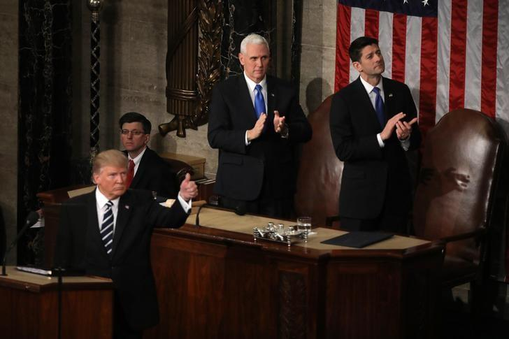 U.S. Trump Addresses Joint Session of Congress - Washington, U.S. 28/02/17 - U.S. President Donald Trump gives a thumbs up as Vice President Mike Pence and Speaker of the House Paul Ryan (R) applaud behind him. REUTERS/Carlos Barria