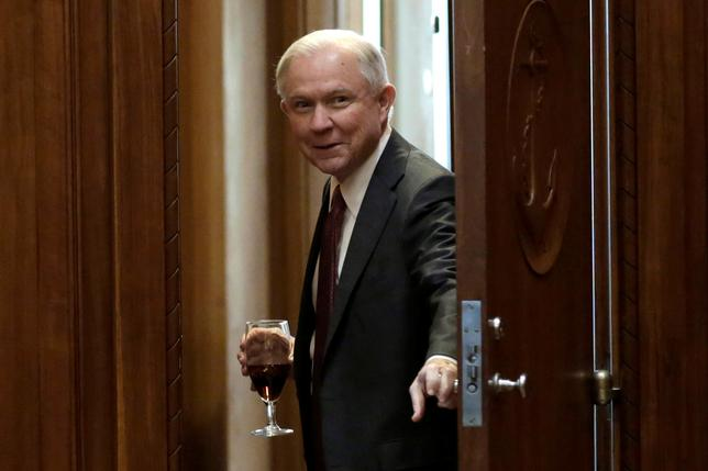 U.S. Attorney General Jeff Sessions opens a door before his first meeting with heads of federal law enforcement components at the Justice Department in Washington, U.S., February 9, 2017. REUTERS/Yuri Gripas/Files