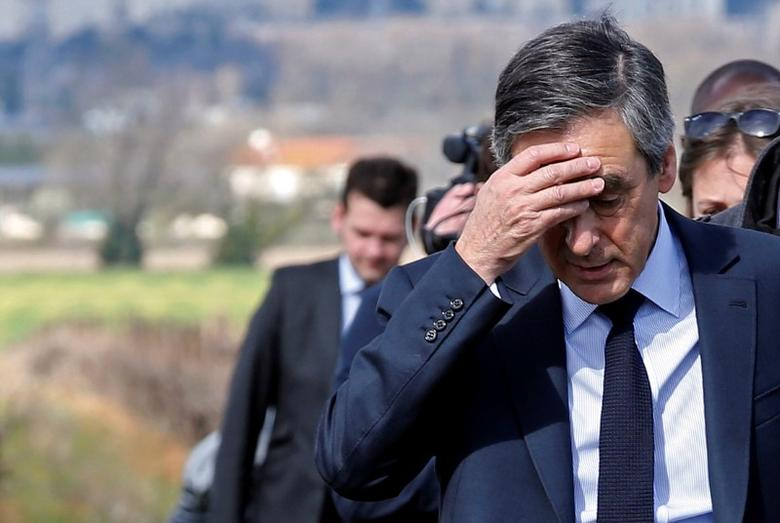 Francois Fillon, former French prime minister, member of the Republicans political party and 2017 presidential election candidate of the French centre-right holds his head as he walks in vineyards before a meeting with winegrowers in Nimes, France, March 2, 2017. REUTERS/Jean-Paul Pelissier