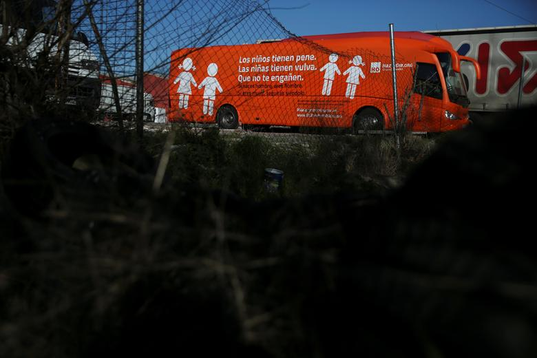 A bus with the anti-transgender message ''Boys have penises, girls have vaginas. Don't let them fool you. If you're born a man, you're a man, if you're a woman, you will continue to be so'' is seen parked at a parking lot in Coslada, outside Madrid, Spain, March 1, 2017. REUTERS/Susana Vera
