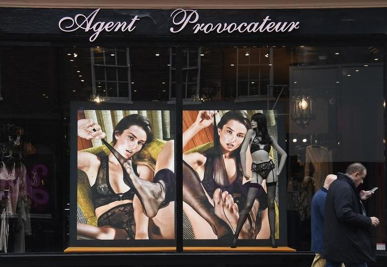 Men walk past a branch of the upmarket lingerie brand, Agent Provocateur in London, Britain, February 21, 2017. REUTERS/Toby Melville