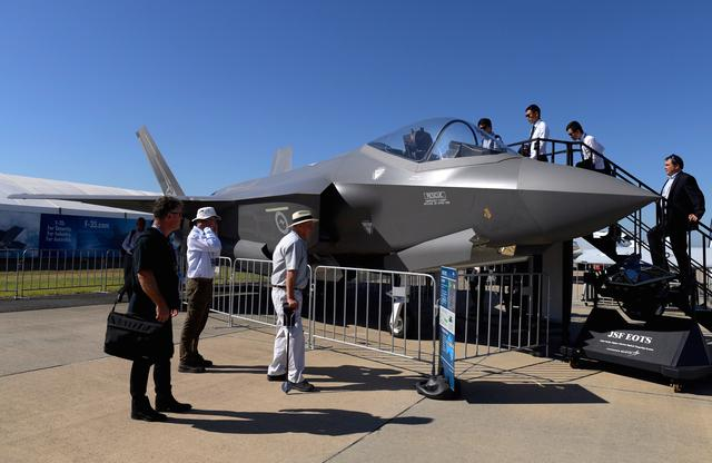 Visitors inspect a Lockheed Martin Corp F-35 stealth fighter jet on display at the Avalon Airshow in Victoria, Australia, March 3, 2017. AAP/Tracey Nearmy/via REUTERS