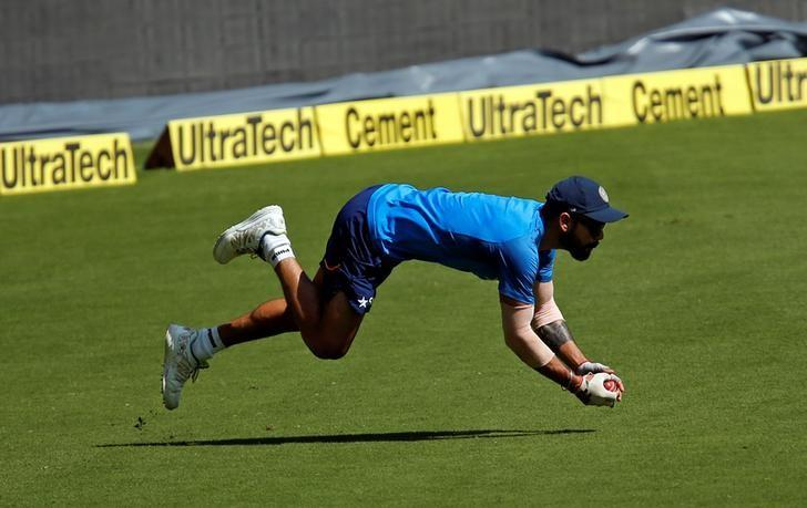 Cricket - India v Australia - India team practice session - M Chinnaswamy Stadium, Bengaluru, India - 03/03/17 - India's captain Virat Kohli dives to catch a ball during a practice session ahead of their second test match. REUTERS/Danish Siddiqui
