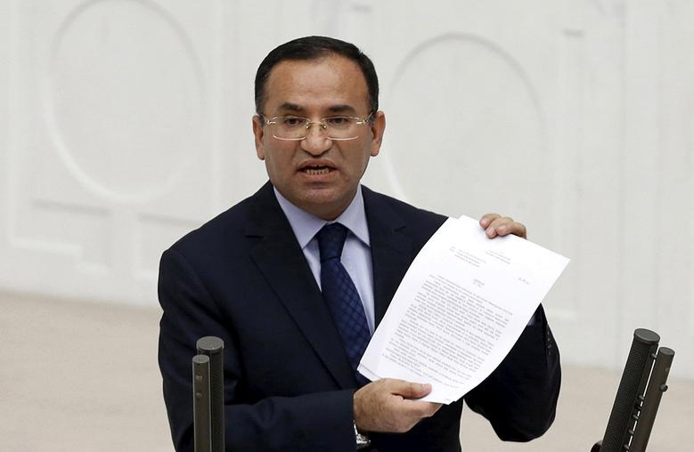 Justice Minister Bekir Bozdag addresses the Turkish Parliament during a debate in Ankara in this March 19, 2014. REUTERS/Umit Bektas/Files