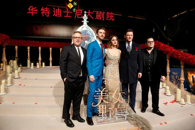 Director Bill Condon and actors Dan Stevens, Emma Watson, Luke Evans, and Josh Gad (L-R) pose for photographers on the red carpet for the film ''Beauty and the Beast'' in Shanghai, China February 27, 2017. REUTERS/Aly Song