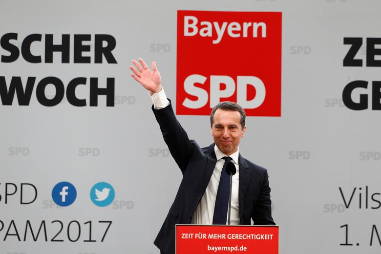 Austrian Chancellor Christian Kern waves during the traditional Social Democratic Party (SPD) Ash Wednesday meeting in Vilshofen, Germany, March 1, 2017. REUTERS/Michaela Rehle