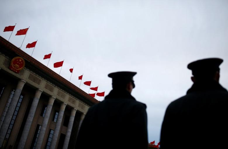 Security personnel stand guard outside the Great Hall of the People ahead of the opening session of the National People's Congress (NPC) in Beijing, China, March 5, 2017. REUTERS/Thomas Peter