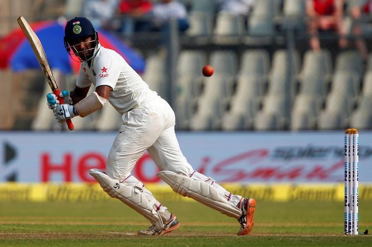 Cricket - India v England - Fourth Test cricket match - Wankhede Stadium, Mumbai, India - 9/12/16. Cheteshwar Pujara plays a shot. REUTERS/Danish Siddiqui