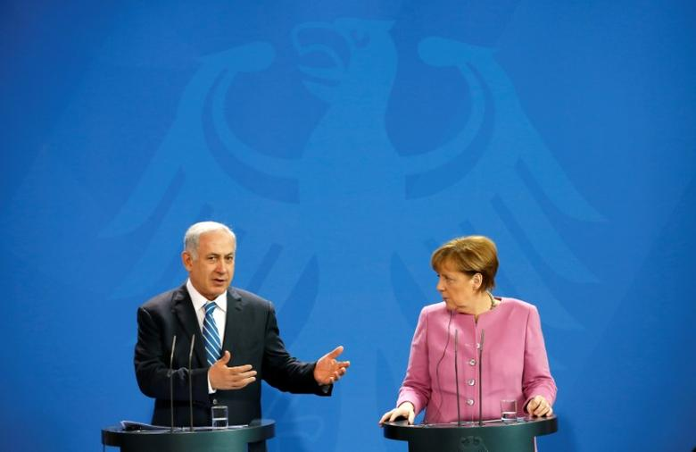 FILE PHOTO: Israeli Prime Minister Benjamin Netanyahu and German Chancellor Angela Merkel address a news conference at the Chancellery in Berlin, Germany, February 16, 2016.        REUTERS/Fabrizio Bensch/File Photo