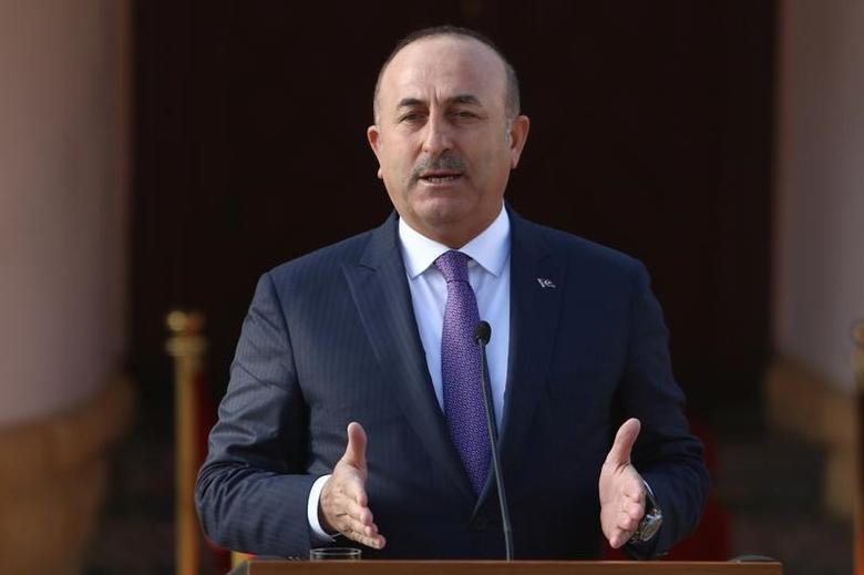 Turkey's Foreign Minister Mevlut Cavusoglu speaks to the media during a visit in Nicosia, northern Cyprus, February 21, 2017. REUTERS/Yiannis Kourtoglou