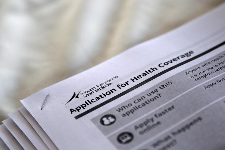 FILE PHOTO - The federal government forms for applying for health coverage are seen at a rally held by supporters of the Affordable Care Act, widely referred to as ''Obamacare'', outside the Jackson-Hinds Comprehensive Health Center in Jackson, Mississippi, U.S. on October 4, 2013.  REUTERS/Jonathan Bachman/File Photo  - RTSXC4M