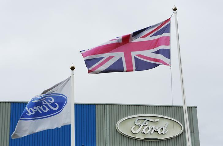 Britain's Union flag flies outside the Ford stamping plant in Dagenham, Essex October 25, 2012. REUTERS/Olivia Harris
