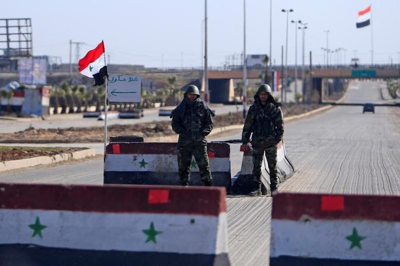 Syrian army soldiers man a checkpoint along a road in Aleppo, Syria February 1, 2017. REUTERS/Ali Hashisho