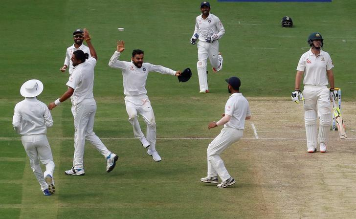 Cricket - India v Australia - Second Test cricket match - M Chinnaswamy Stadium, Bengaluru, India - 05/03/17. India's captain Virat Kohli (C) celebrates the wicket of Australia's Mitchell Marsh with team mates. REUTERS/Danish Siddiqui