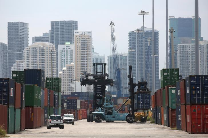 A mule truck moves a container in the Port of Miami in Miami, Florida, U.S., May 19, 2016. REUTERS/Carlo Allegri