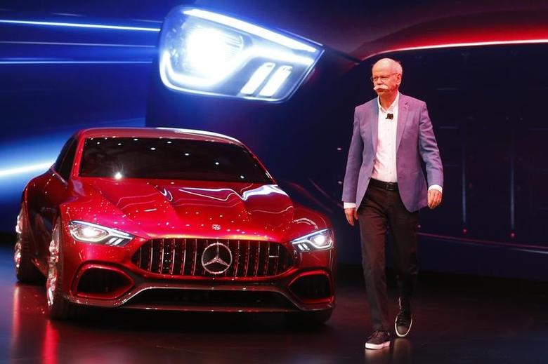 Dieter Zetsche, CEO of Daimler AG, walks past Mercedes-AMG GT Concept car during the 87th International Motor Show at Palexpo in Geneva, Switzerland, March 7, 2017. REUTERS/Arnd Wiegmann