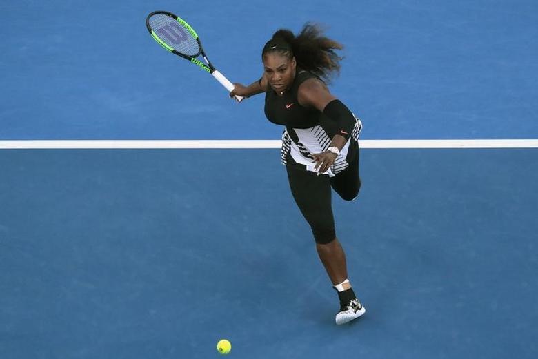 Tennis - Australian Open - Melbourne Park, Melbourne, Australia - 28/1/17 Serena Williams of the U.S. runs to hit a shot during her Women's singles final match against Venus Williams of the U.S. .REUTERS/Jason Reed