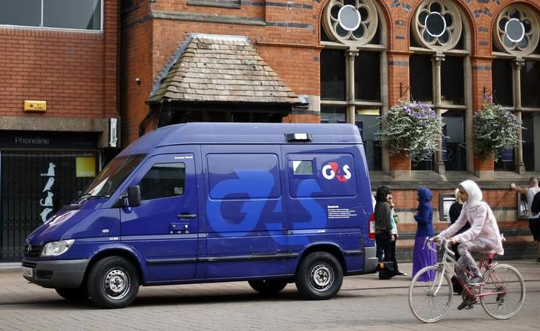 A G4S security van is seen parked outside a bank in Loughborough, central England, August 28, 2013. REUTERS/Darren Staples/File Photo