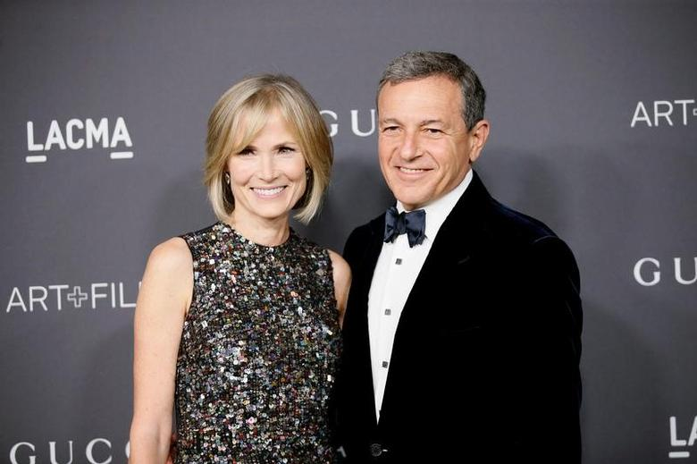 Walt Disney Company President and Chief Executive Officer Bob Iger (R) and wife Willow Bay (L) pose at the Los Angeles County Museum of Art (LACMA) Art+Film Gala in Los Angeles, October 29, 2016. REUTERS/Danny Moloshok