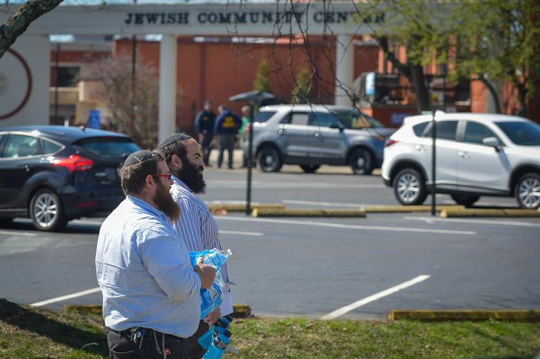 Rabbis with the local community share water with first responders as local and federal officers respond to the bomb threat at the Jewish Community Center in Louisville, Kentucky, U.S., March 8, 2017.  REUTERS / Bryan Woolston