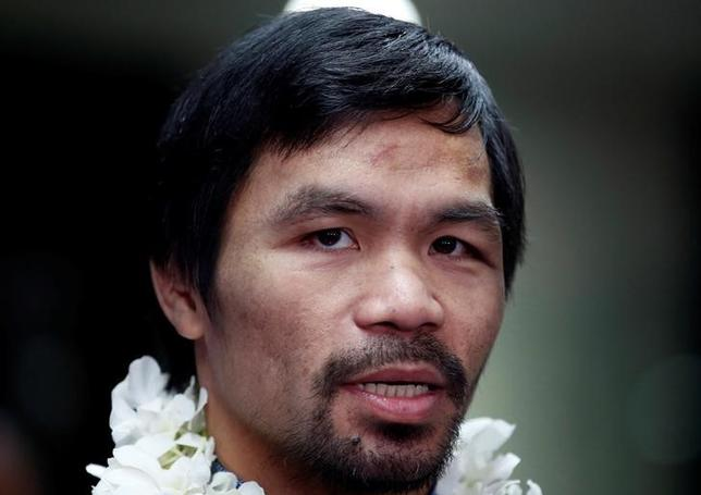 3月8日、ボクシングの元8階級王者、マニー・パッキャオ(写真)のプロモーターは、アミル・カーン(英国)との対戦が延期になったと明かした。フィリピンのニノイ・アキノ国際空港で2016年11月撮影(2017年 ロイター/Erik De Castro)