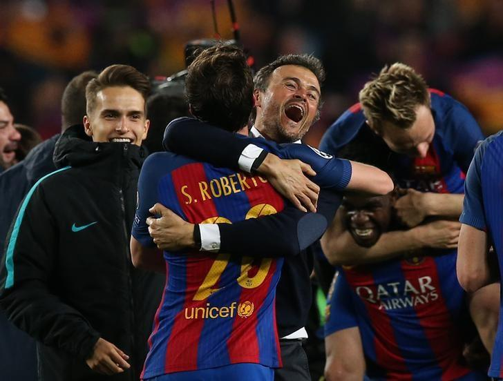 Football Soccer - Barcelona v Paris St Germain - UEFA Champions League Round of 16 Second Leg - The Nou Camp, Barcelona, Spain - 8/3/17 Barcelona coach Luis Enrique and Sergi Roberto celebrate after the game  Reuters / Albert Gea Livepic