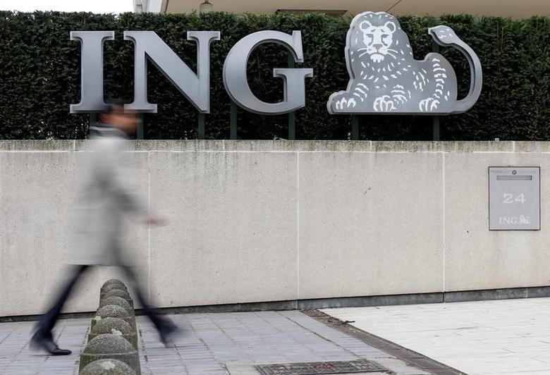 A pedestrian walks past the logo of ING bank by the group's main office in Brussels, Belgium, October 3, 2016. REUTERS/Francois Lenoir
