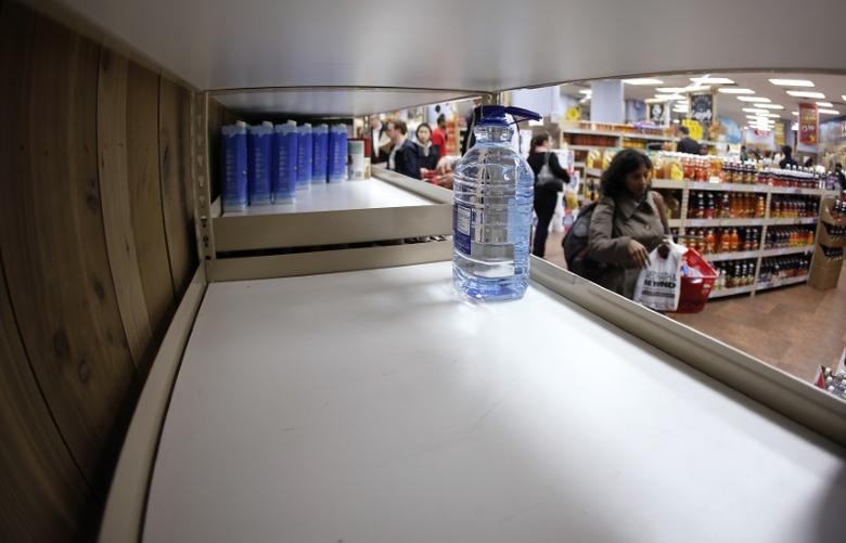 One bottle of water remains on the shelf at Trader Joe's supermarket in New York October 28, 2012. REUTERS/Carlo Allegri