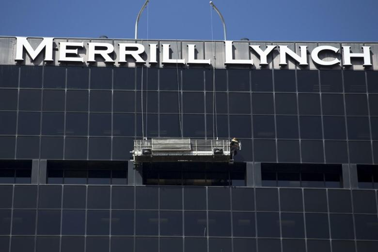A worker washes windows high atop the Merrill Lynch building in downtown San Diego, California  September 1, 2015. REUTERS/Mike Blake