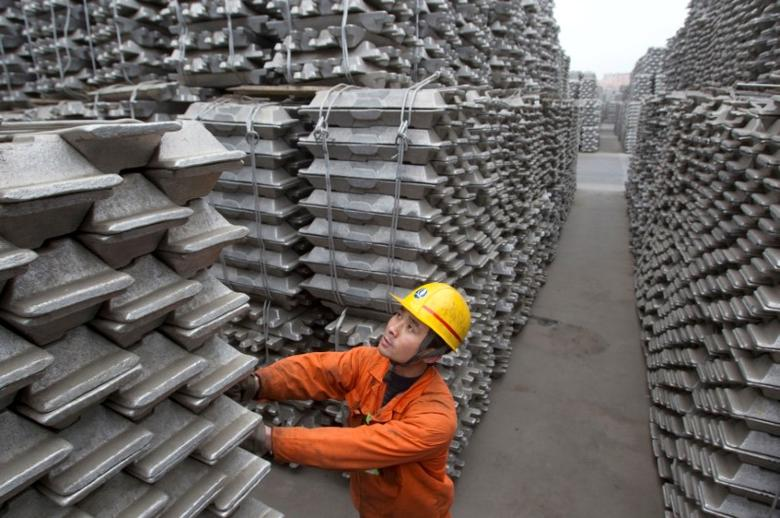 An employee checks aluminium ingots for export at the Qingdao Port, Shandong province March 14, 2010.   REUTERS/Stringer/File Photo