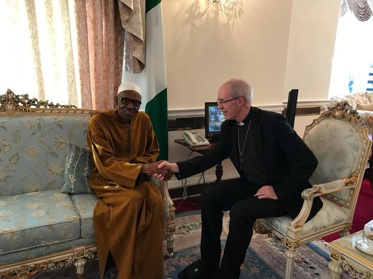 Archbishop of Canterbury, Justin Welby sits with Nigeria's President Muhammadu Buhari in Abuja House, London, Britain March 9, 2017. Nigeria Presidential Office/Handout via REUTERS