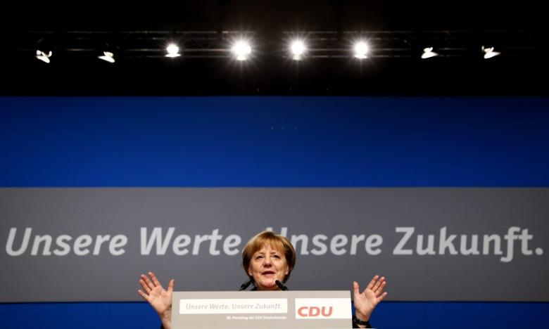 German Chancellor and leader of the conservative Christian Democratic Union party CDU Angela Merkel delivers her closing speech of the CDU party convention in Essen, Germany, December 7, 2016.     REUTERS/Wolfgang Rattay