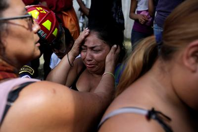 Mourning girls burned to death in Guatemala shelter