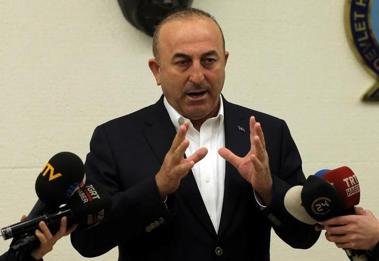 Turkish Foreign Minister Mevlut Cavusoglu speaks during a news conference at Ataturk International airport in Istanbul, Turkey, March 11, 2017. REUTERS/Huseyin Aldemir