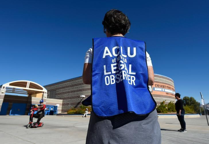 File photo: A member of the ACLU observes a polling station during voting in the 2016 presidential election at Desert Pines High School in Las Vegas, Nevada, U.S November 8, 2016.  REUTERS/David Becker