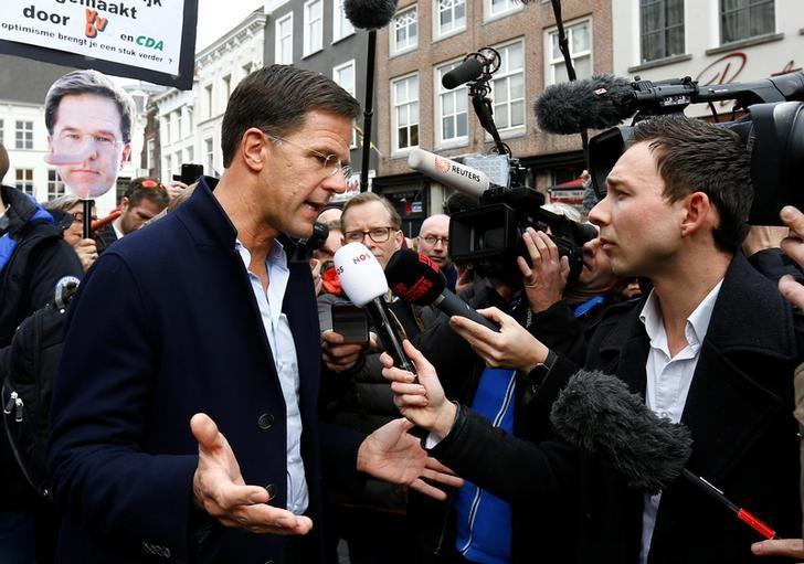 Dutch Prime Minister Mark Rutte of the VVD Liberal party speaks to the media as he campaigns for the 2017 Dutch election in Breda, Netherlands March 11, 2017. REUTERS/Michael Kooren