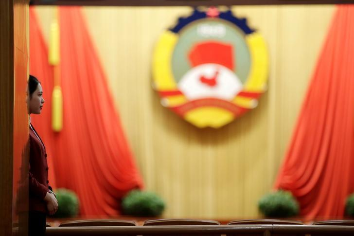 An attendant stands ahead of the closing session of the Chinese People's Political Consultative Conference (CPPCC) at the Great Hall of the People in Beijing, China, March 13, 2017. REUTERS/Jason Lee