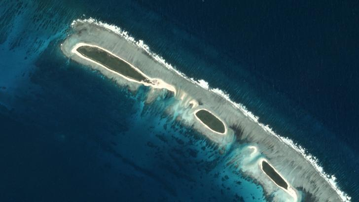 A destroyed land bridge (top) is seen in this view of a North Island, near Tree Island and Woody Island in the Paracel chain, in the South China Sea November 14, 2016 in this Planet Labs handout photo received by Reuters on November 30, 2016. Trevor Hammond/Planet Labs/Handout via REUTERS/File Photo