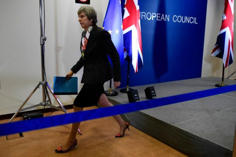 Britain's Prime Minister Theresa May leaves a news conference during the EU Summit in Brussels, Belgium, March 9, 2017. REUTERS/Dylan Martinez