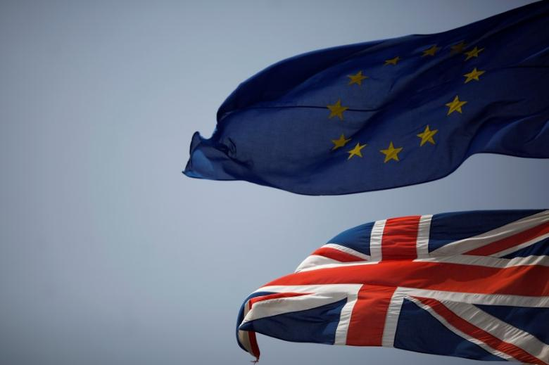 The Union Jack (bottom) and the European Union flag are seen flying, at the border of Gibraltar with Spain, in the British overseas territory of Gibraltar, historically claimed by Spain, June 27, 2016, after Britain voted to leave the European Union in the EU Brexit referendum. REUTERS/Jon Nazca/Files