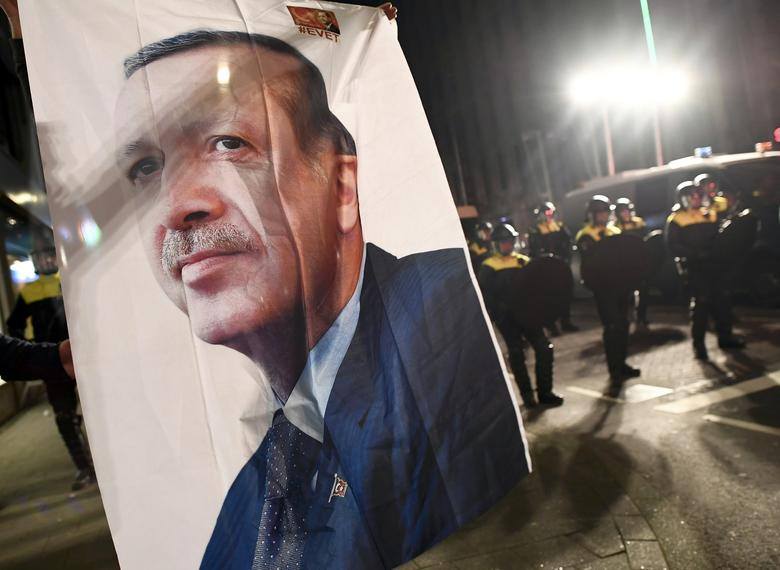 A large image of Turkish President Recep Tayyip Erdogan placed outside the Turkish consulate during protests in Rotterdam, Netherlands March 11, 2017.     REUTERS/YDylan Martinez