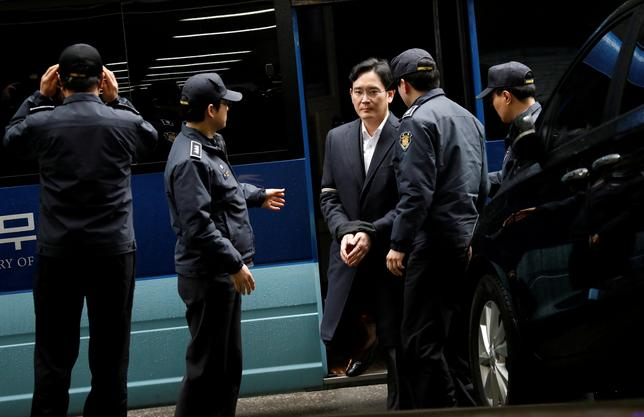 FILE PHOTO: Samsung Group chief, Jay Y. Lee arrives at the office of the independent counsel team in Seoul, South Korea, February 22, 2017.    REUTERS/Kim Hong-Ji/File Photo