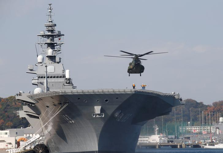 A helicopter lands on the Izumo, Japan Maritime Self Defense Force's (JMSDF) helicopter carrier, at JMSDF Yokosuka base in Yokosuka, south of Tokyo, Japan, December 6, 2016. REUTERS/Kim Kyung-Hoon/File Photo