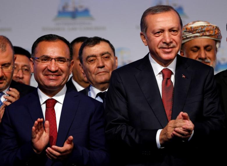 FILE PHOTO: Turkish President Tayyip Erdogan (R) is pictured wit Justice Minister Bekir Bozdag during the International Istanbul Law Congress in Istanbul, October 17, 2016. REUTERS/Murad Sezer/File