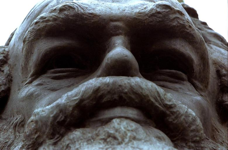 FILE PHOTO: A monument to Karl Marx stands above his remains at the Highgate Cemetary in North London February 24. May 5 marks the 180th anniversary of the birth of Marx in Trier, Germany./CLH/File Photo