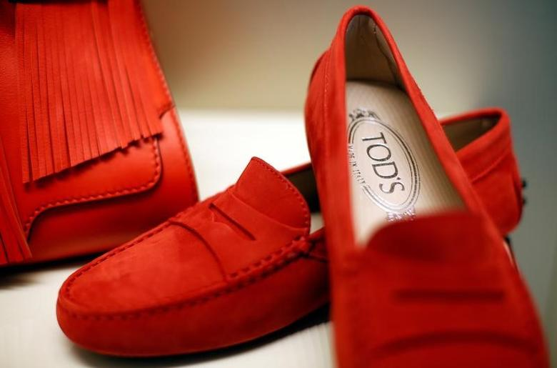 A pair of shoes of the Italian luxury shoemaker Tod's are displayed in Sant'Elpidio a Mare April 17, 2014. REUTERS/Max Rossi/File Photo