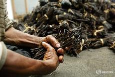 Labourers sort pods of vanilla for export from the Indian Ocean Comoros islands,  file.