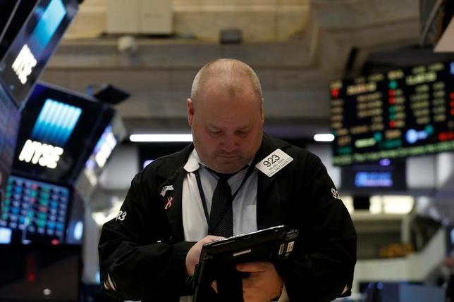 A trader works on the floor of the New York Stock Exchange. REUTERS/Brendan McDermid