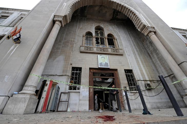 Blood stains the ground near a police line after a suicide blast, at the entrance of the Palace of Justice in Damascus, Syria March 15, 2017. REUTERS/Omar Sanadiki